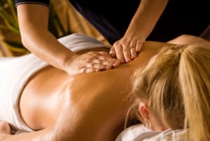 woman at a day spa getting a back massage